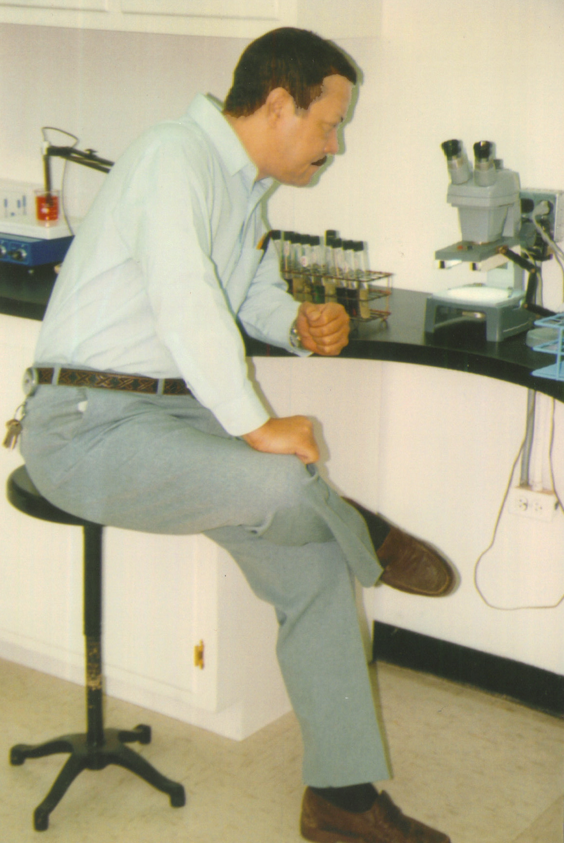 Henri Inspects Counting Microscope